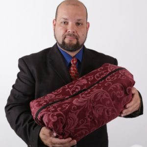 photo of man holding precious cargo transporter infant funeral